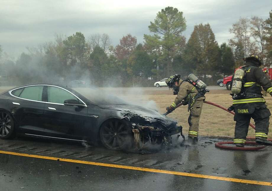 Just make sure your ride doesn't get too hot, like this Model S that suffered an electrical fire after running over debris that damaged the undercarriage. Photo: Evan Crosby, Special To The Chronicle