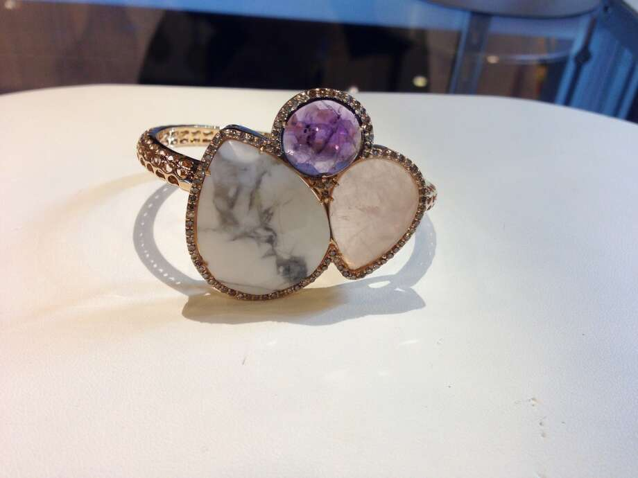 A rose gold cuff featuring Amethyst, Chalcedony,and petrified stone at Peran & Scannell Jewelers Photo: Lindsey Love