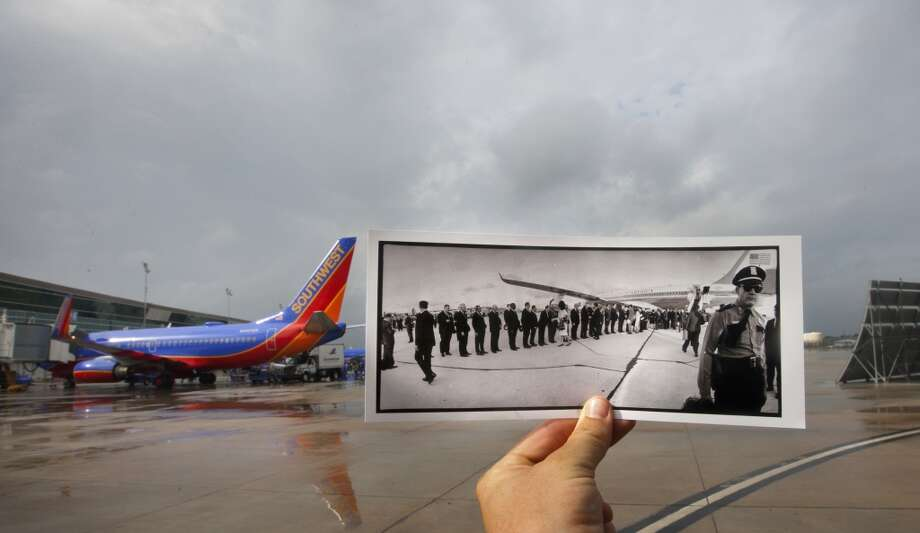 A photo showing President John F. Kennedy shaking hands with 22 prominent Houstonians after he and First Lady Jacqueline Kennedy arrived at Houston International Airport, in Houston, November 21, 1963 is juxtaposed against the current day William P. Hobby Airport, Wednesday, Oct. 30, 2013, in Houston. The airport's name was changed to William P. Hobby Airport in 1967 in honor of the Texas governor, and the current-day terminal was finished in 2003. The original location where Air Force One was parked in the original photo is no longer an open area, it is now a parking toll plaza.   (Cody Duty / Houston Chronicle) Photo: Cody Duty, Houston Chronicle