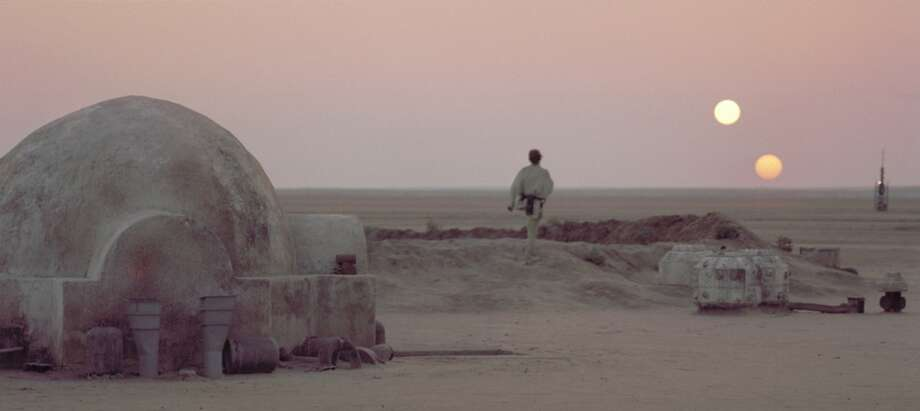 "After discussing his future plans with his Uncle Owen, Luke Skywalker leaves the Lars Homestead and heads towards the vista to watch the twin suns of Tatooine set while he reflects upon his destiny in a scene from the film ""Star Wars."". Photo: LUCASFILM LTD."