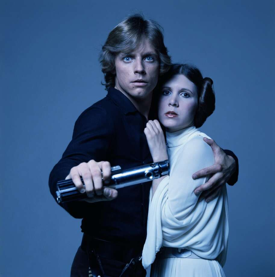 American actors Mark Hamill and Carrie Fisher in costume as brother and sister Luke Skywalker and Princess Leia in George Lucas' Star Wars trilogy, 1977. (Photo by Terry O'Neill/Getty Images) Photo: Getty Images