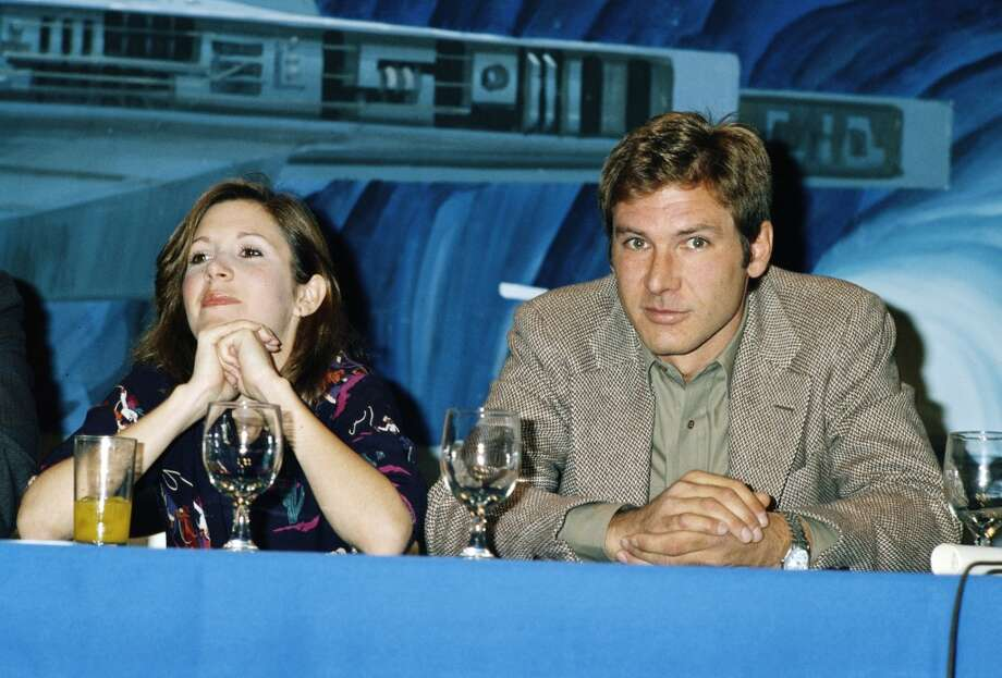 American actors Carrie Fisher and Harrison Ford at a press conference for one of the 'Star Wars' films, circa 1980. (Photo by Maureen Donaldson/Getty Images) Photo: Getty Images