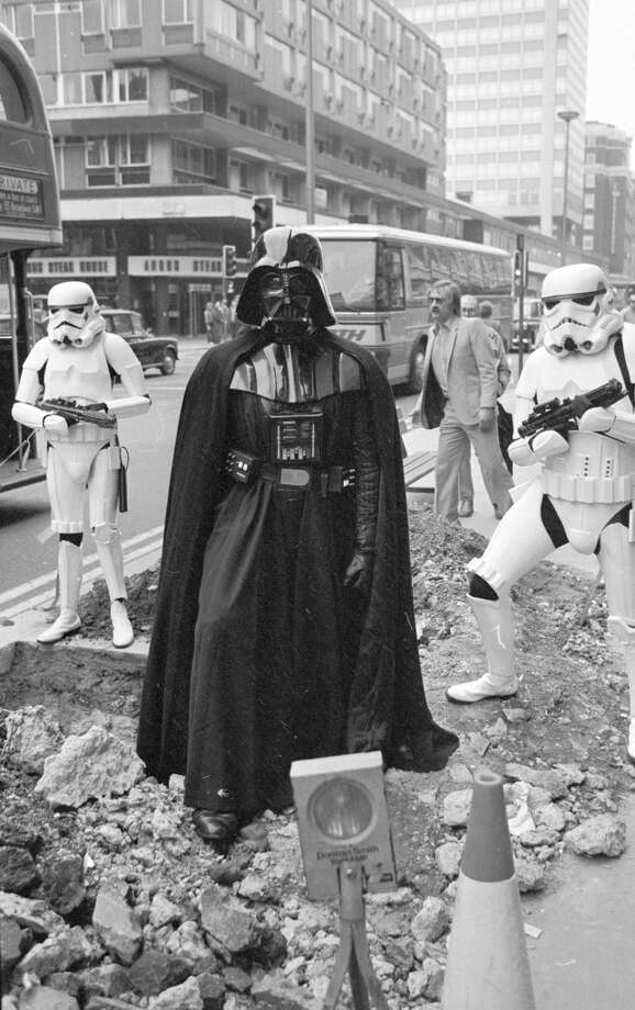 31st March 1980:  Darth Vader and two stormtroopers from the film 'Star Wars' stand menacingly over some road works in London's Oxford Street.  (Photo by Central Press/Getty Images) Photo: Getty Images