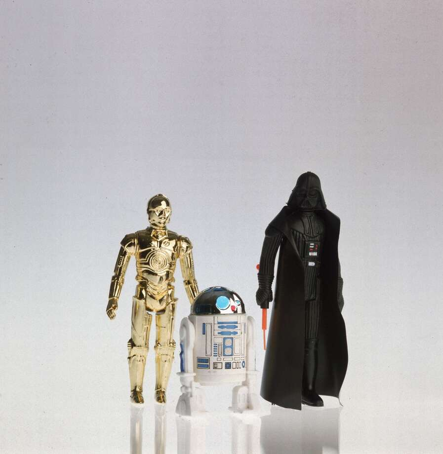 View of three action figures derived from the science fiction film 'Star Wars,' 1979. Pictured are, from left, robot duo C3PO and R2D2, and masked villian Darth Vader. (Photo by Henry Groskinsky/Time & Life Pictures/Getty Images) Photo: Time & Life Pictures/Getty Image