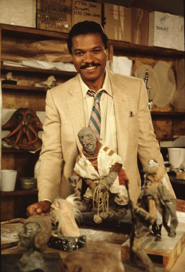 Promotional portrait of American actor Billie Dee Williams as he poses with an assortment of maquettes on the set of 'Classic Creatures: Return of the Jedi' (directed by Robert Guenette), a documentary about the second film in the Star Wars saga that focuses on variety of unusual beings that populate the film's world; the program was originally broadcast on November 21, 1983. Among the maquettes visible is the character Pote Snitkin (seen directly in front of Williams) and the head of Tessek (on the shelf behind William's right arm). (Photo by CBS Photo Archive/Hulton Archive) Photo: Getty Images