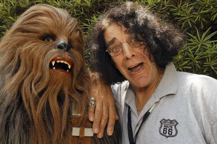 "**FILE**Actor Peter Mayhew, right, who played Chewbacca in the ""Star Wars"" movies, poses with a Chewbacca character, on May 27, 2005, during ""Star Wars Weekends"" at Walt Disney World Resort in Lake Buena Vista, Fla. Mayhew, 60, was among more than 400 people from 77 countries who became a U.S. citizen in a ceremony in Arlington, Texas, Monday, Oct. 17, 2005. Mayhew now lives in Granbury, Texas, west of Dallas-Fort Worth, and makes appearances at science fiction conventions around the country.(AP Photo/Walt Disney World, Mark Ashman) Photo: AP"