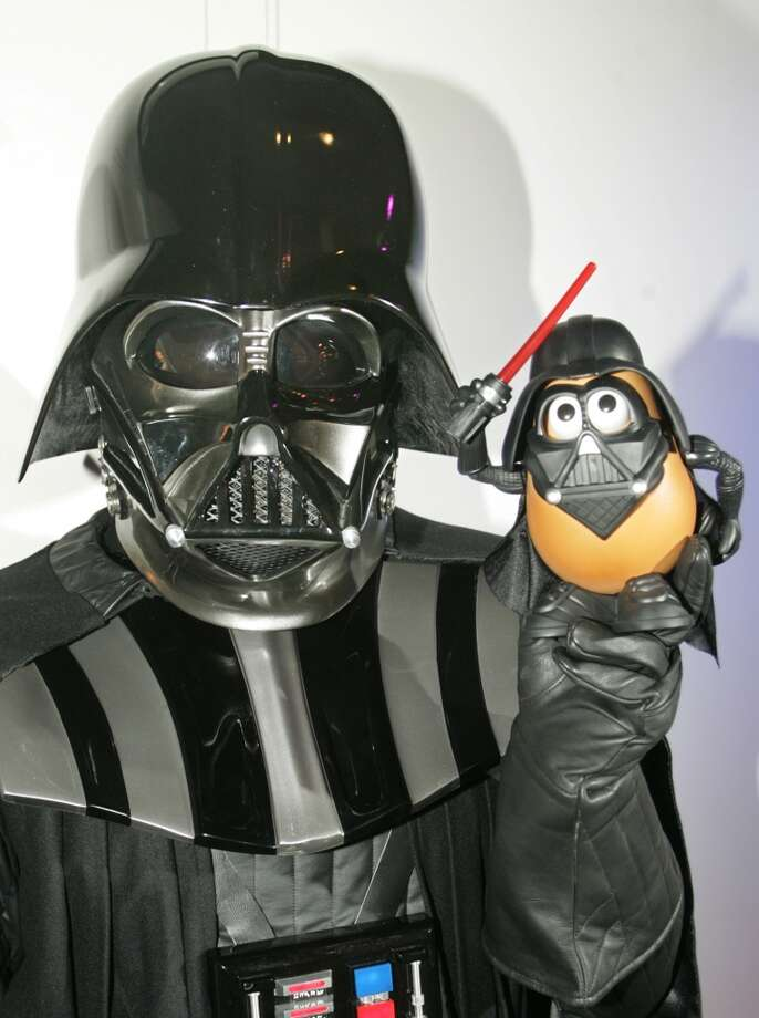 Kris Krajewski, dressed as Darth Vader holds 'Darth Tater,' the newly introduced 'Mr. Potato Head' toy in the Hasbro showroom during preparations for the opening of the American International Toy Fair in New York, Wednesday, February 16, 2005. Krajewski belongs to a costuming organization that supports professionally organized charity, fundraising and promotional events that feature the villain of Star Wars. (AP Photo/HO/Ray Stubblebine/Hasbro) Photo: AP