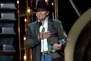 San Antonio's George Strait speaks to the audience at the Country Music Awards.