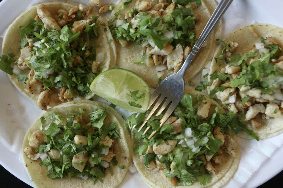 Monterrey taquitos offer a choice of meat (above, chicken) and a topping of onion and cilantro. Photo: Helen L. Montoya / San Antonio Express-News