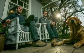Graeme, (beard), and Alex MacDonald with their dog, Honeybee in Oakville, Calif. on Wednesday, October 30th, 2013.