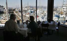 Michael and Pamela Sanderson of Los Altos enjoy the waterfront view and lunch at Tarantino's in San Francisco, Calif. on Friday, Nov. 1, 2013.