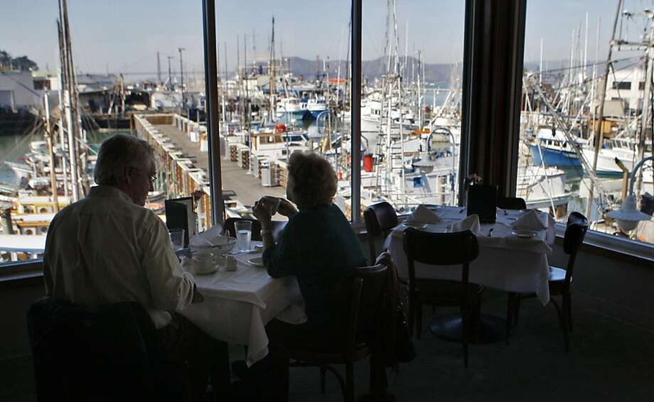 Michael and Pamela Sanderson of Los Altos enjoy lunch at Tarantino's, which features expansive views of the boats at Fisherman's Wharf and the bay beyond. Photo: Raphael Kluzniok, The Chronicle