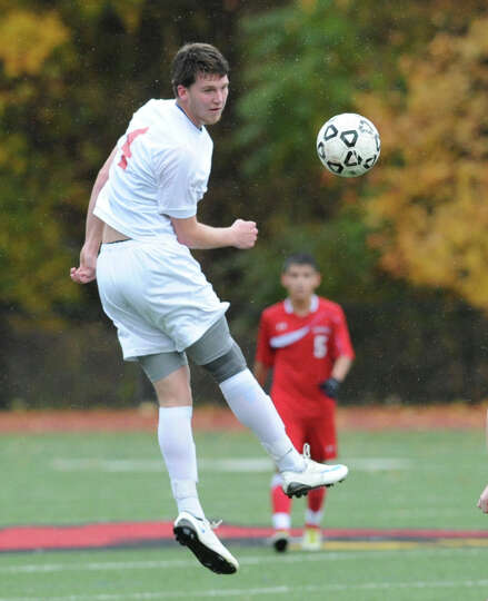 Will Gittings of Greenwich heads the ball during the Class LL boys soccer playoff game between Green