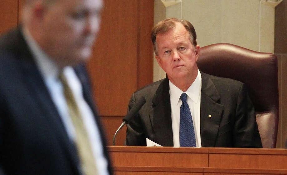 Newly selected District 9 councilman Joe Krier takes his seat on the city council dais on Thursday, Nov. 7, 2013. Photo: Kin Man Hui, San Antonio Express-News / ©2013 San Antonio Express-News