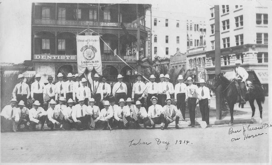 This photograph was taken for the Labor Day parade of 1914. Behind  the electrical workers on Alamo Plaza is the Maverick Bank Building. Photo: Courtesy Photo