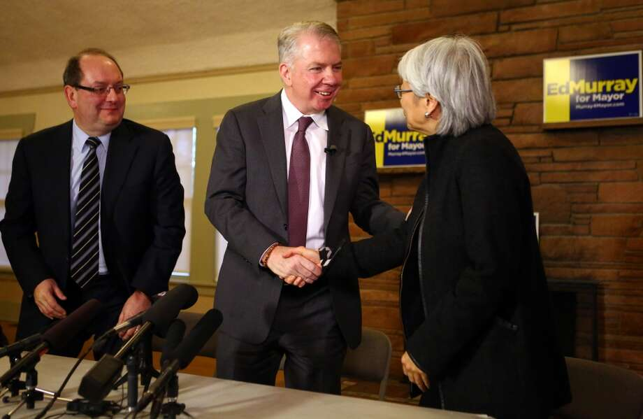 Seattle mayor elect Ed Murray introduces Martha Choe and Dwight Dively as co-chairs of his transition team during a news conference at the Lakewood, Seward Park Community Club on Thursday, November 7, 2013. Earlier in the day his opponent, Seattle Mayor Mike McGinn conceded the election. (Joshua Trujillo, seattlepi.com) Photo: SEATTLEPI.COM