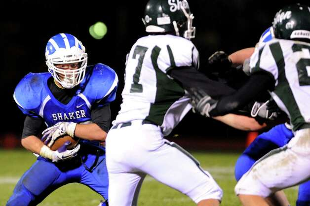Shaker's Jake Quay, left, looks for room to run during their Class AA quarterfinal football game against Shenendehowa on Friday, Oct. 25, 2013, at Shaker High in Latham, N.Y. (Cindy Schultz / Times Union) Photo: Cindy Schultz / 00024383A