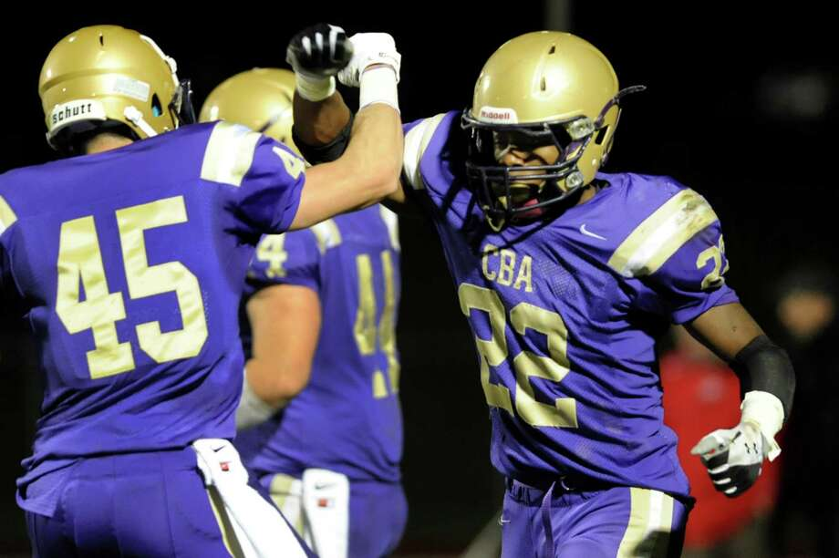 CBA's Elliot Croskey, right, celebrates a touchdown with teammate Alex Koshgarian during their Class AA semifinal football game against Guilderland on Friday, Nov. 1, 2013, at Christian Brothers Academy in Colonie, N.Y. (Cindy Schultz / Times Union) Photo: Cindy Schultz / 00024470A
