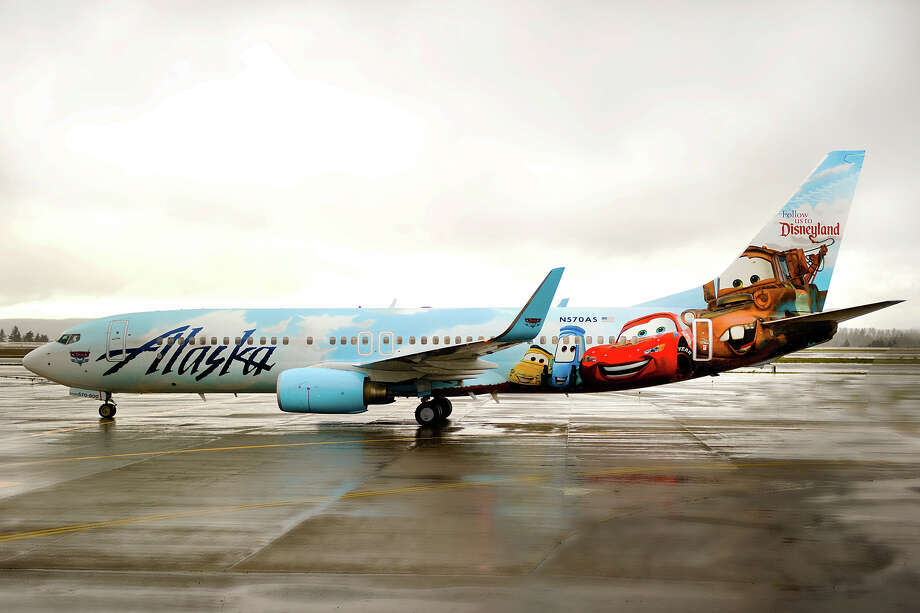 """Seattle-based Alaska Airlines introduced its new """"Adventure of Disneyland Resort"""" Boeing 737on Thursday, Nov. 7, 2013 at Seattle-Tacoma International Airport. Photo: Alaska Airlines"""