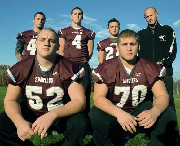 Burnt Hills High School football players Roz Warren, front left, Nico Fragale, right, left to right standing, David Newell, Dan Porter, Josh Quesada and head coach Matt Shell on Wednesday Nov. 6, 2013 in Burnt Hills, N.Y. (Michael P. Farrell/Times Union) Photo: Michael P. Farrell / 00024531A