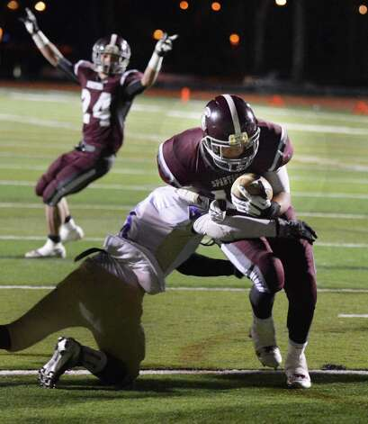 Burnt Hills' #24 Josh Quesada ,top left, signals a touchdown as teammate #11 Dan Maynard scores again in the Class A Super Bowl game against Amsterdam at Shenendehowa High Saturday Nov. 3, 2012.   (John Carl D'Annibale / Times Union) Photo: John Carl D'Annibale / 00019922A