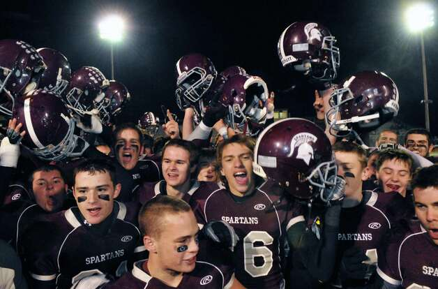 Burnt Hills plyers celebrate after beating Amsterdam High to win the Class A Super Bowl at Shenendehowa High School in Clifton Park Saturday Nov. 5, 2011.   (John Carl D'Annibale / Times Union) Photo: John Carl D'Annibale / 00015203A