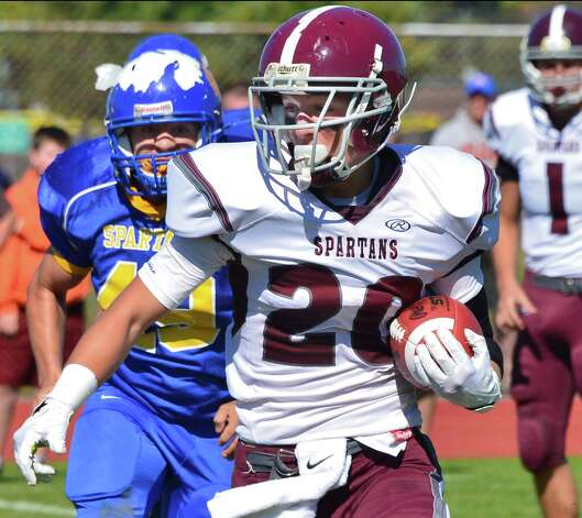 Burnt Hills' #20 Tyler Dowdle runs the ball during their game against Queensbury Saturday Sept. 28, 2013, in Queensbury, NY. (John Carl D'Annibale / Times Union) Photo: John Carl D'Annibale / 00024014A