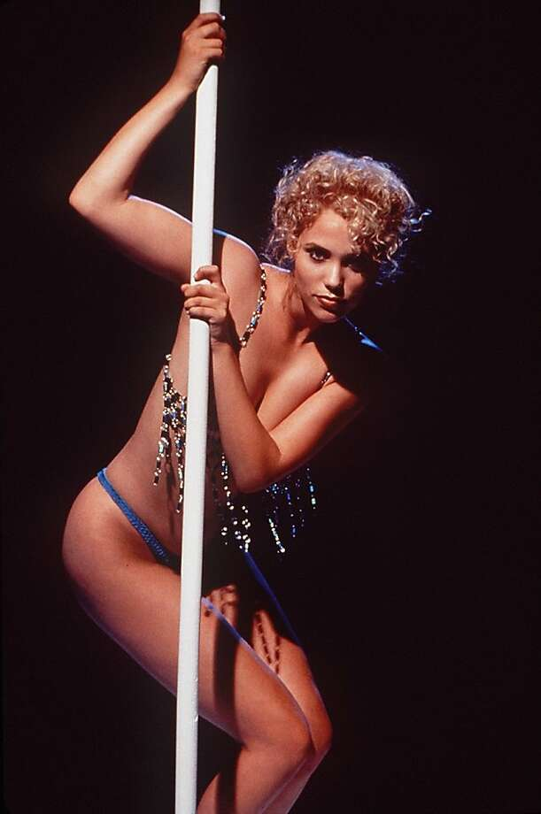 """Ah, """"Showgirls."""" What can we say that hasn't already been said about thisPaul Verhoeven-directeddisaster-turned-cult-classic? We're still scarred by the pool sex scene. Photo: Douglas Kirkland"""