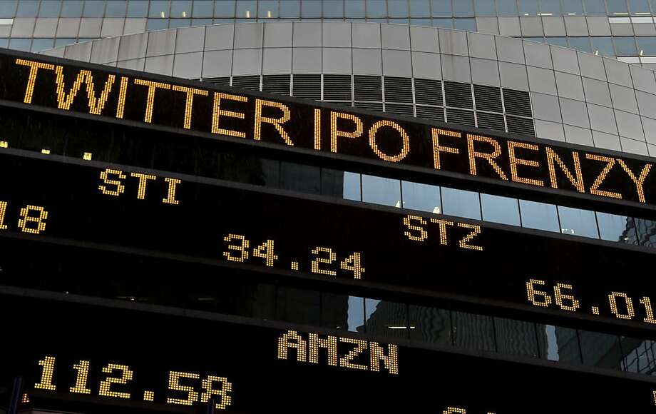 News about Twitter's public stock debut is displayed on a screen in Times Square, New York, Thursday, Nov. 7, 2013. The company's stock opened at $45.10 when it began trading Thursday on the New York Stock Exchange.  (AP Photo/Seth Wenig) Photo: Seth Wenig, Associated Press
