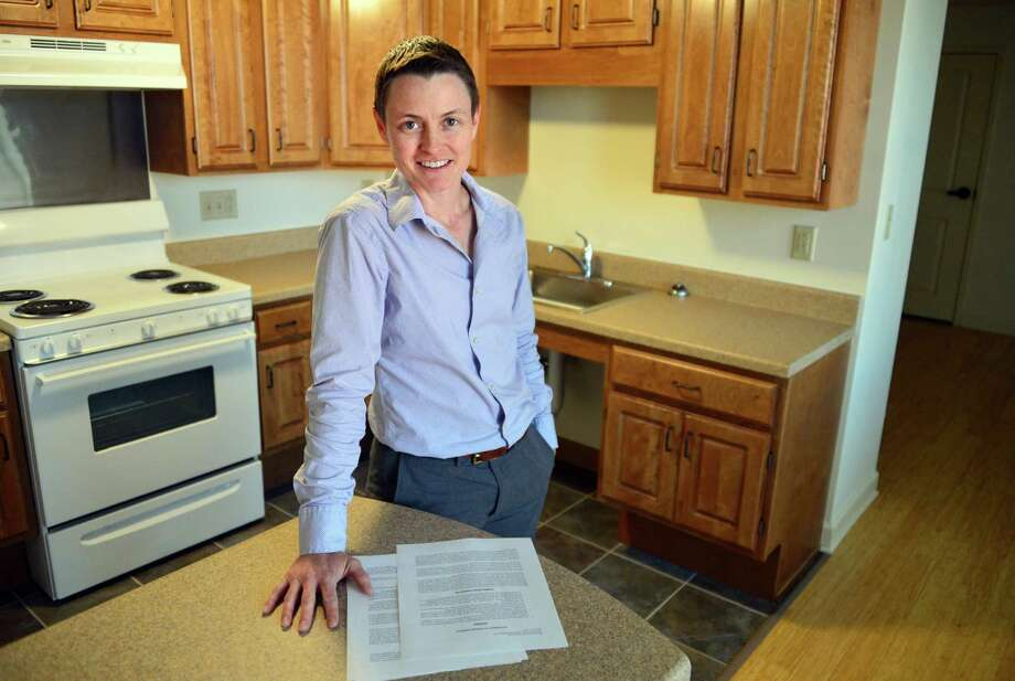 Jennica Petrik-Huff, building project manager for the Community Builders Inc. a nonprofit developer, in kitchen of a newly renovated apartment  at Monument Square Apartments Thursday Nov. 7, 2013, in Troy, NY.  (John Carl D'Annibale / Times Union) Photo: John Carl D'Annibale / 00024550A