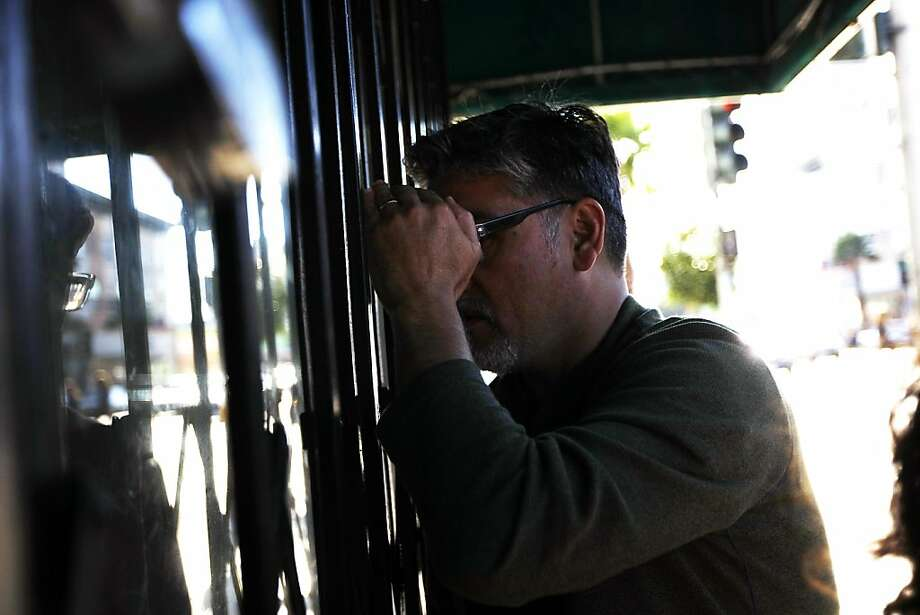 District 11 Supervisor John Avalos peers into an Excelsior neighborhood storefront that is allegedly used for gambling. Photo: Michael Short, The Chronicle