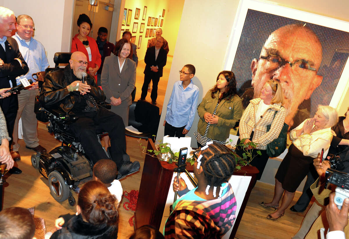 Artist Chuck Close, left, thanks the children from Roosevelt School, who took part in President Barack Obama's Turnaround Arts initiative, during a show of his work and the children's artwork at the Housatonic Museum of Art inside the Burt Chernow Galleries at Housatonic Community College in Bridgeport, Conn. on Thursday November 7, 2013. The show was part of the 5th Annual Bridgeport Art Trail event which is held at art galleries all over the city for four days.