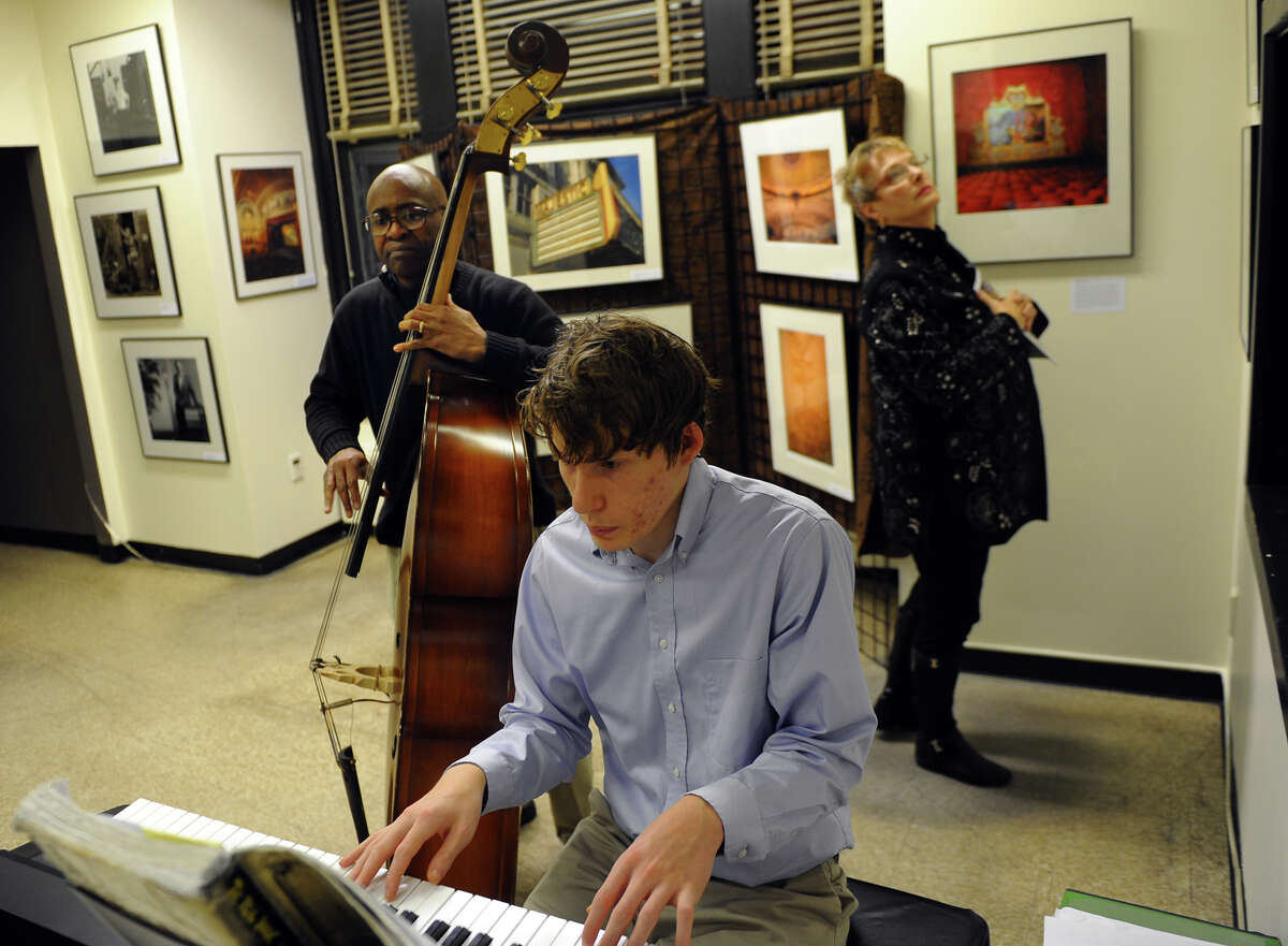 Musicians Neddy Smith, on bass, and Thomas Ice, on piano, entertain guests at an art space inside McLevy Hall in downtown Bridgeport, Conn. on Thursday November 7, 2013. The show was part of the 5th Annual Bridgeport Art Trail event which is held at art galleries all over the city for four days.