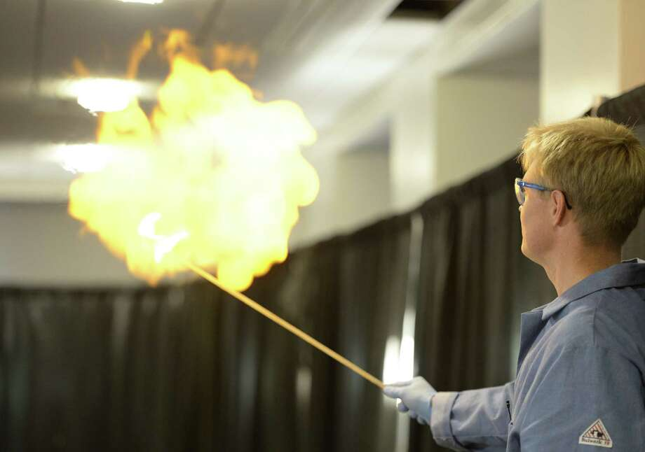 Dave Moore, PhD plays the part of Post-Doc as he explodes a hydrogen balloon during a magic versus science show at the 25th anniversary of Science Day Thursday Nov. 7, 2013.  at the GE Global Research center in Niskayuna, N.Y.  Moore showed students from around the capital region about chemical reactions in comparison to magic reactions.    (Skip Dickstein / Times Union) Photo: Skip Dickstein / 00024541A