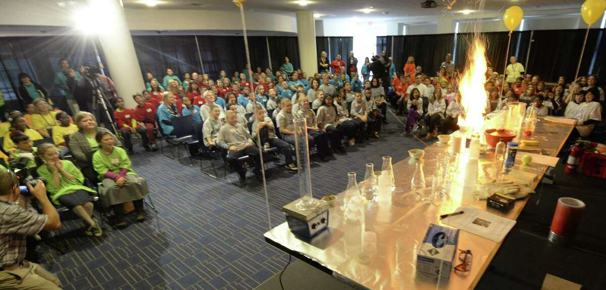 Students from across the capital region watch chemical reactions during a magic versus science show at the 25th anniversary of Science Day Thursday Nov. 7, 2013. at the GE Global Research center in Niskayuna, N.Y. Moore showed students from around the capital region about chemical reactions in comparison to magic reactions. (Skip Dickstein / Times Union)