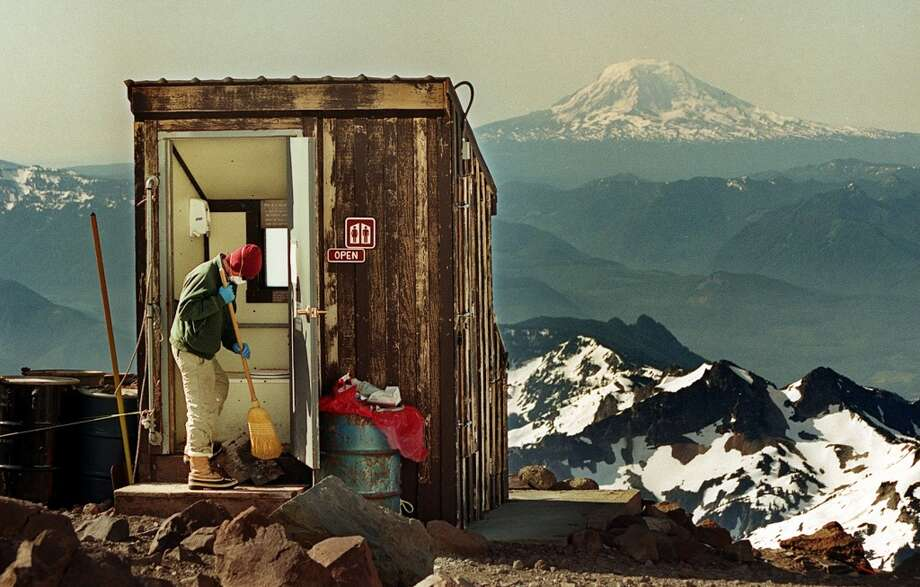 There's nothing like doing your business at 10,808 feet elevation. This solar toilet on Mount Rainier is at Camp Muir, the high-altitude refuge for climbers heading to the summit. (Mount Adams is in the background). Photo: DAN DELONG, SEATTLE POST INTELLIGENCER