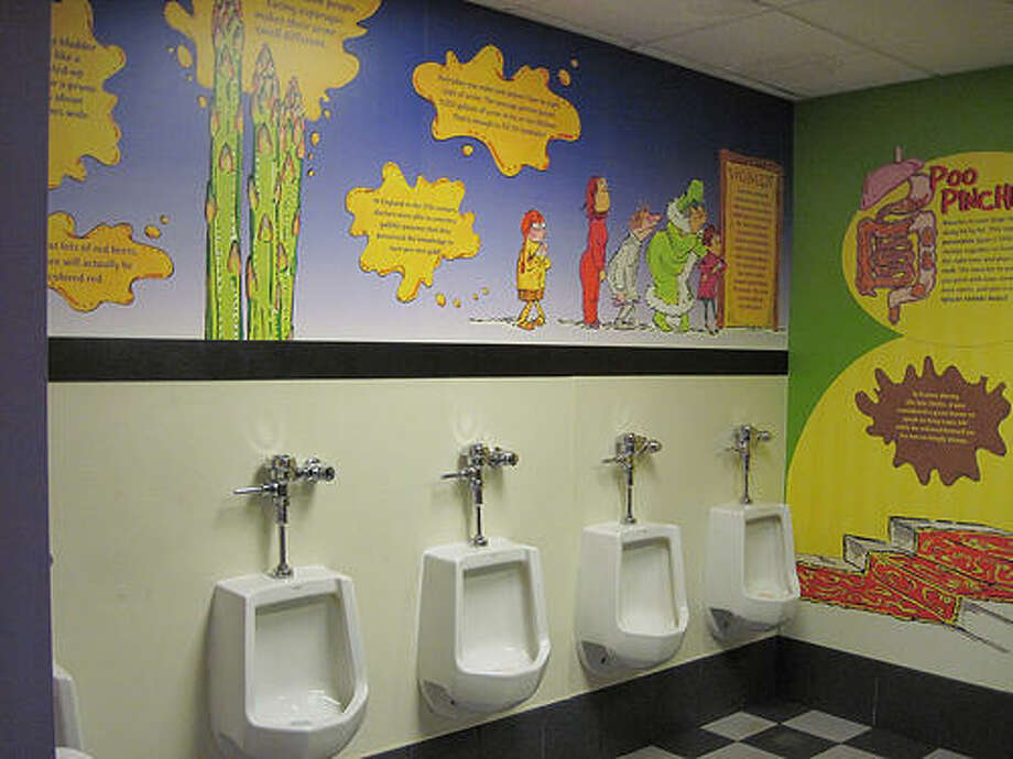 """Where else in Seattle can you go to the bathroom with instructive illustrations on the mechanics of """"poo pinching?""""   This is the Pacific Science Center bathroom, so totally appropriate. (You can see some of the illustration on the far right wall).   (Photo: spaetz, Flickr)."""