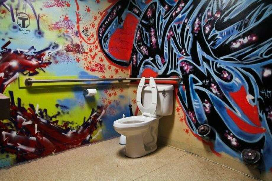 Sometimes a little color enlivens the white throne. (Men's bathroom at  the Night Owl hookah bar in the University District). Photo: Joe Dyer/seattlepi.com