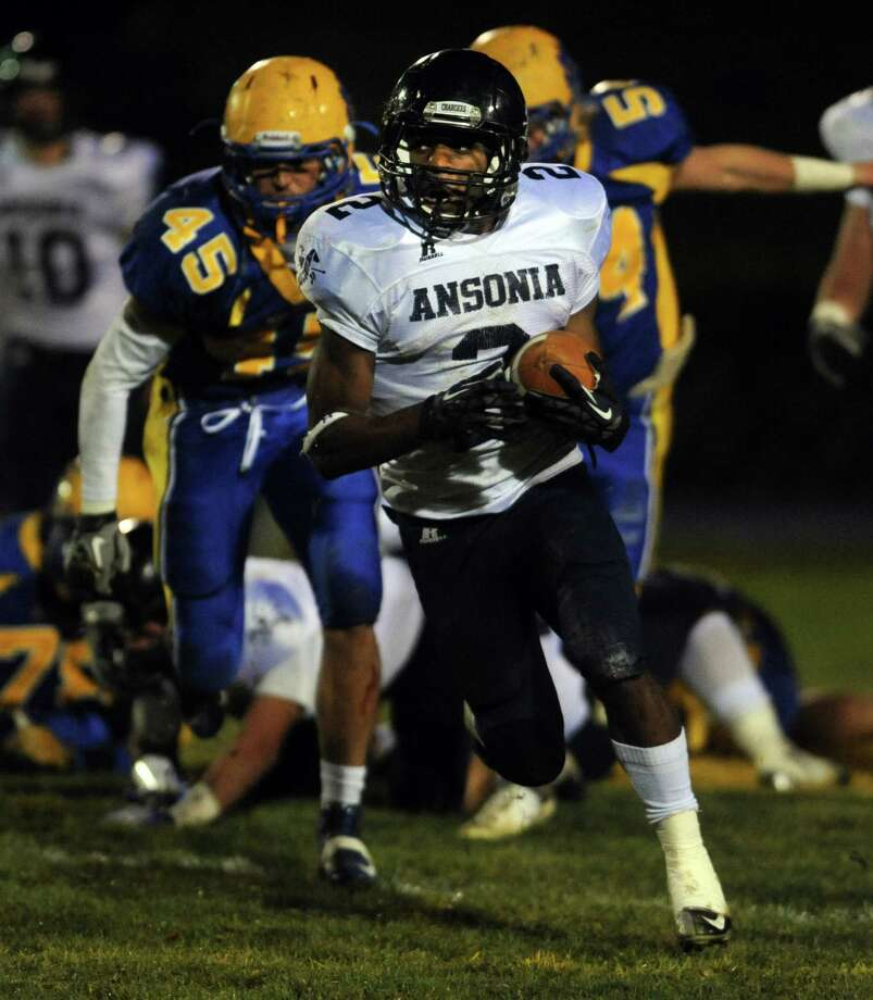 Ansonia's Arkeel Newsome carries the ball Thursday, Nov. 7, 2013 during their football game against Seymour High School in Seymour, Conn. Photo: Autumn Driscoll / Connecticut Post