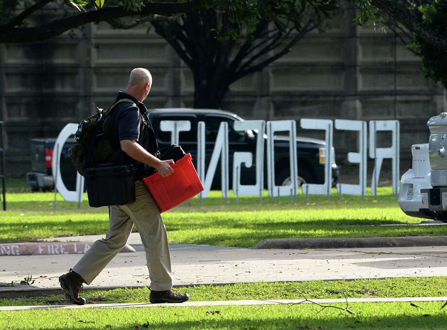An FBI agent carries equipment needed to conduct an investigation at the BISD Administration Office on Thursday. The inquiry is said by a BISD spokesperson to be based on a possible diversion of district funds.  Photo taken Thursday, November 07, 2013 Guiseppe Barranco/@spotnewsshooter Photo: Guiseppe Barranco, Photo Editor