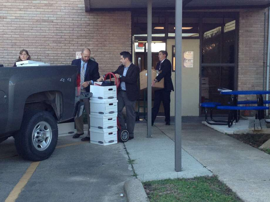 FBI agents load boxes of evidence into a truck behind the BISD administration building. Federal authorities opened an investigation Thursday into allegations that someone set-up bogus accounts and diverted district funds. Photo: Brooke Crum