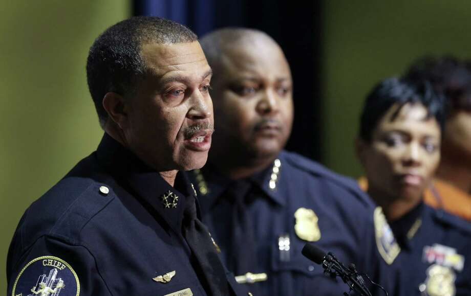 Detroit Police Chief James Craig (left) dis-cusses Wednesday's barbershop shootings. He said a man is being ques-tioned about the shootings that left three dead and six wounded. Photo: Carlos Osorio / Associated Press