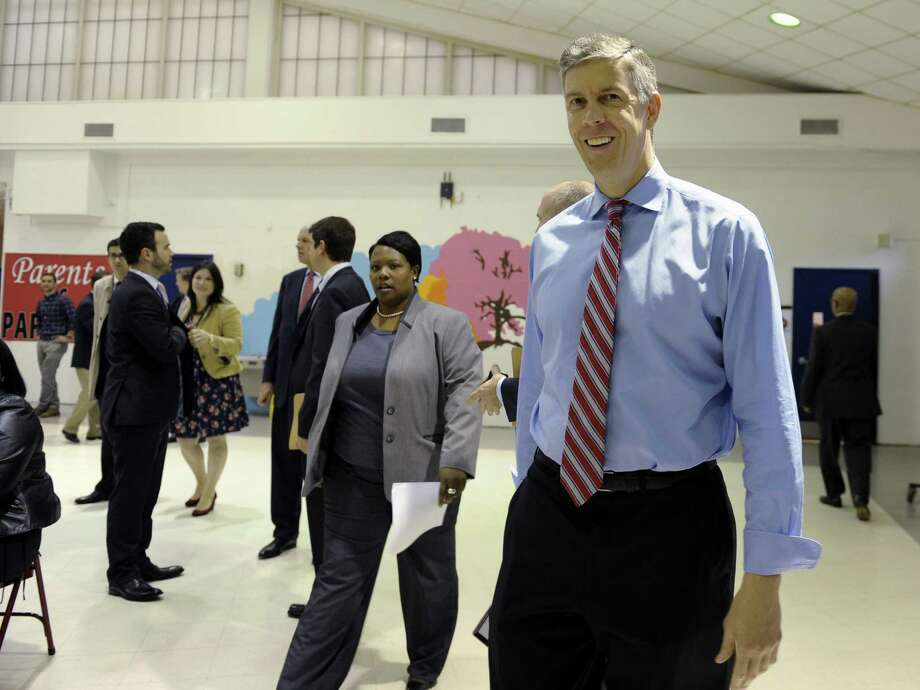 Education Secretary Arne Duncan visits Malcolm X Elementary School in Wash- ington, where he discussed the Nation's Report Card. Photo: Susan Walsh / Associated Press