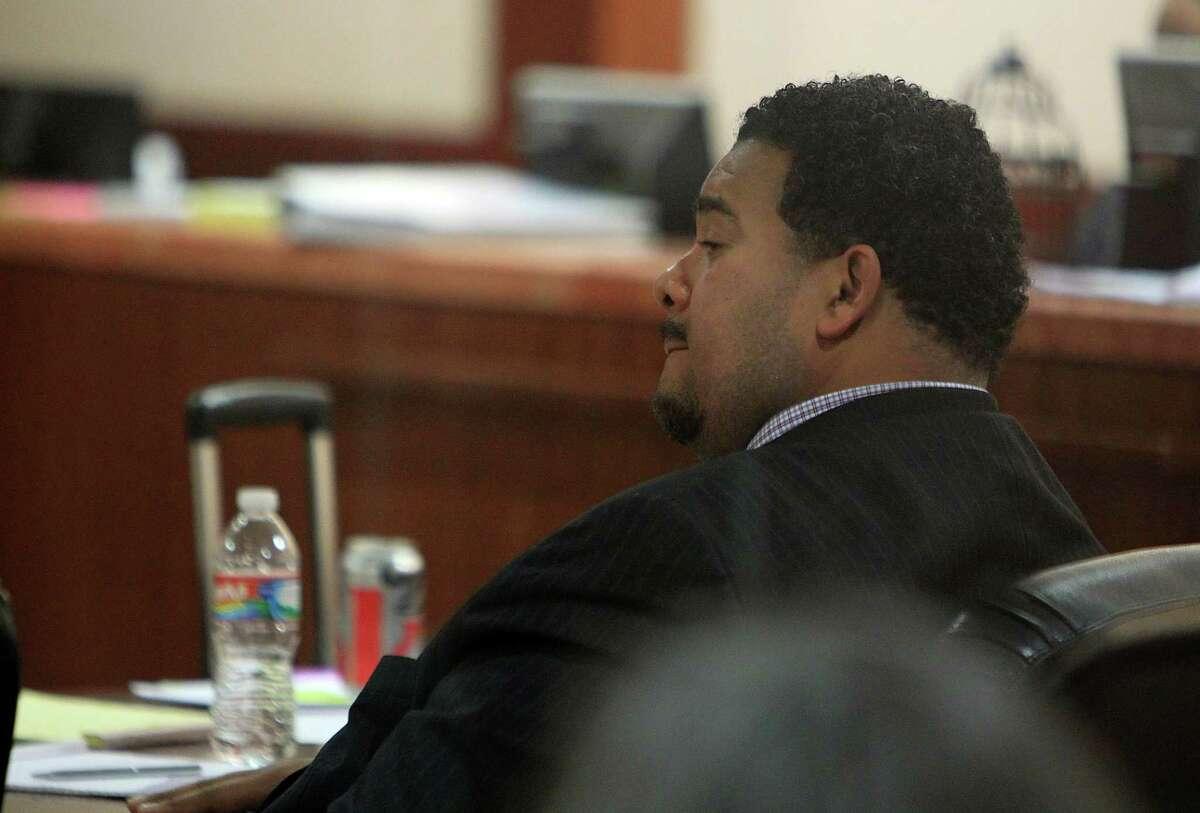 """Efram Holmes' attorneys say he was a """"gentle bear,"""" trying to protect his clients."""