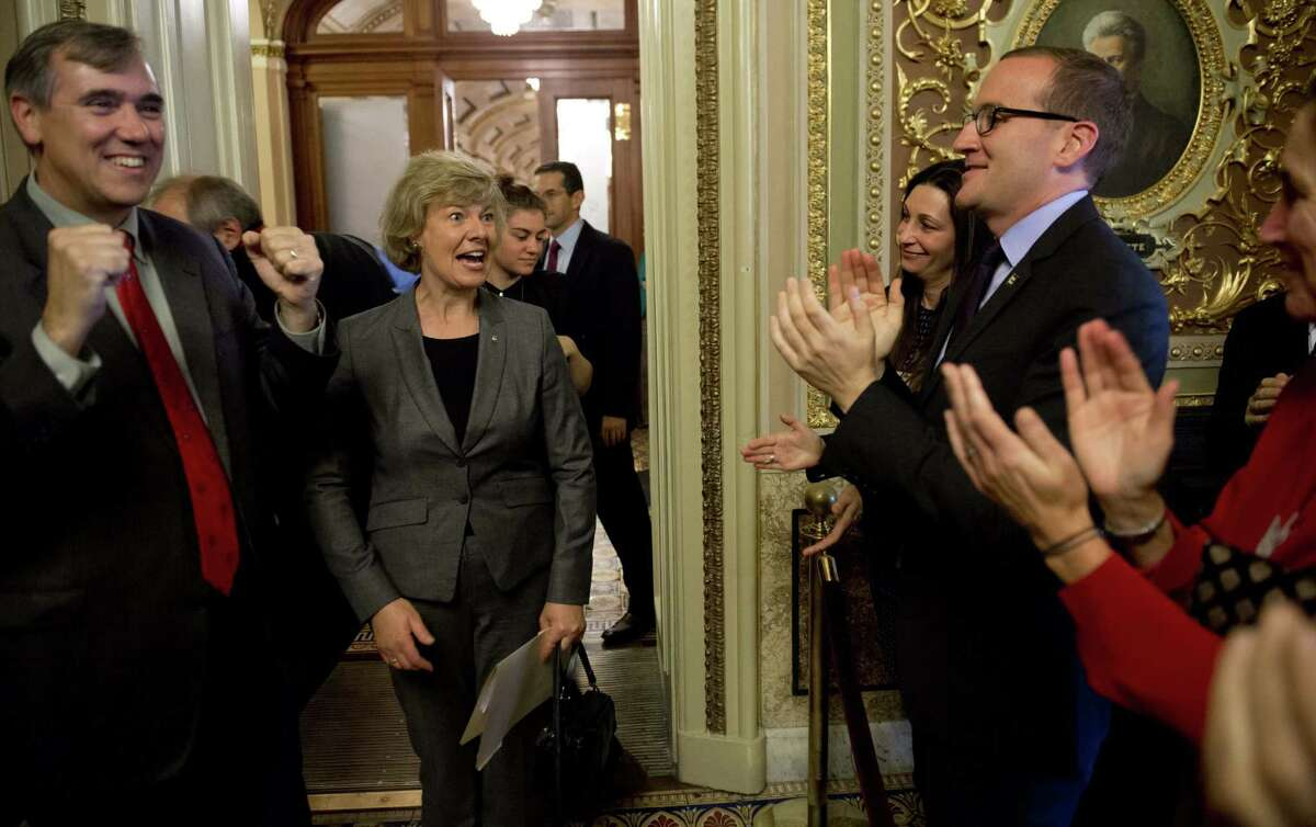 U.S. Sen. Tammy Baldwin, R-Wis. (center), who is openly gay, joins supporters after Senate passage of the Employment Nondiscrimination Act. At left is Sen. Jeff Merkley, D-Ore.
