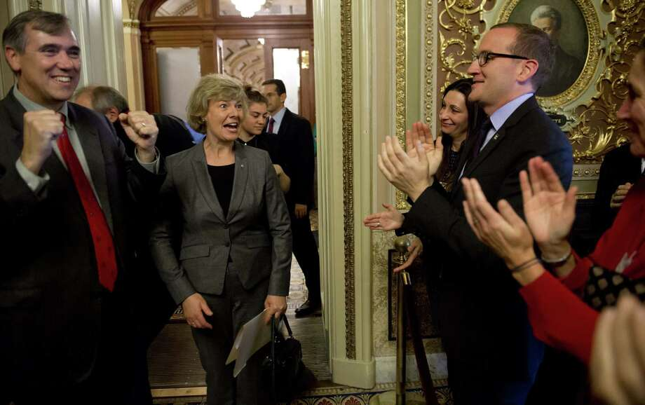 U.S. Sen. Tammy Baldwin, R-Wis. (center), who is openly gay,  joins supporters after Senate passage of the Employment Nondiscrimination Act. At left is Sen. Jeff Merkley, D-Ore. Photo: AFP/Getty Images