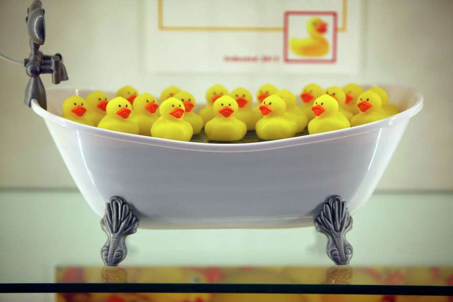 Rubber ducks are on display during the National Toy Hall of Fame ceremony at the National Museum of Play at The Strong in Rochester, N.Y., Thursday, Nov. 7, 2013. The rubber duck and the ancient game of chess were inducted into the Toy Hall of Fame Thursday, beating out 10 other finalists including bubbles, the board game Clue, and Nerf toys. (AP Photo/Democrat & Chronicle, Carlos Ortiz)  MAGS OUT; NO SALES ORG XMIT: NYROD106 Photo: Carlos Ortiz / Democrat & Chronicle