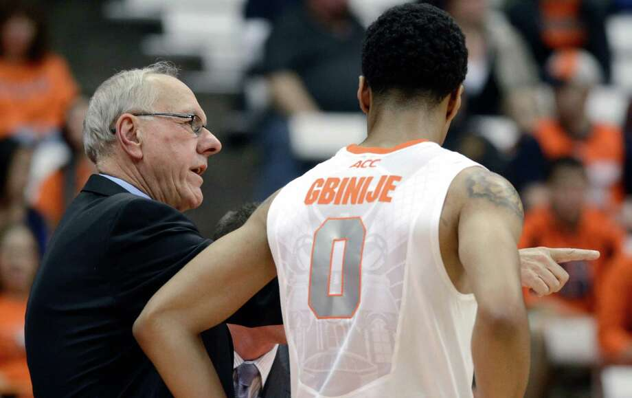 Syracuse head coach Jim Boeheim talks with Michael Gbinije during the first half of a men's NCAA exhibition college basketball game in Syracuse, N.Y., Tuesday, Nov. 5, 2013. (AP Photo/Kevin Rivoli) ORG XMIT: NYKR101 Photo: KEVIN RIVOLI / FR60349 AP