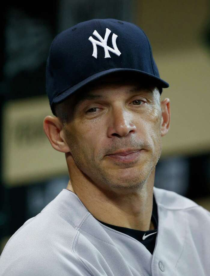 FILE - OCTOBER 9:  According to reports October 9, 2013, Joe Girardi has signed a four-year contract to continue to manage the New York Yankees. HOUSTON, TX - SEPTEMBER 28:  Manager Joe Girardi #28 of the New York Yankees waits in the dugout before the game against the Houston Astros at Minute Maid Park on September 28, 2013 in Houston, Texas.  (Photo by Scott Halleran/Getty Images) ORG XMIT: 163495796 Photo: Scott Halleran / 2013 Getty Images