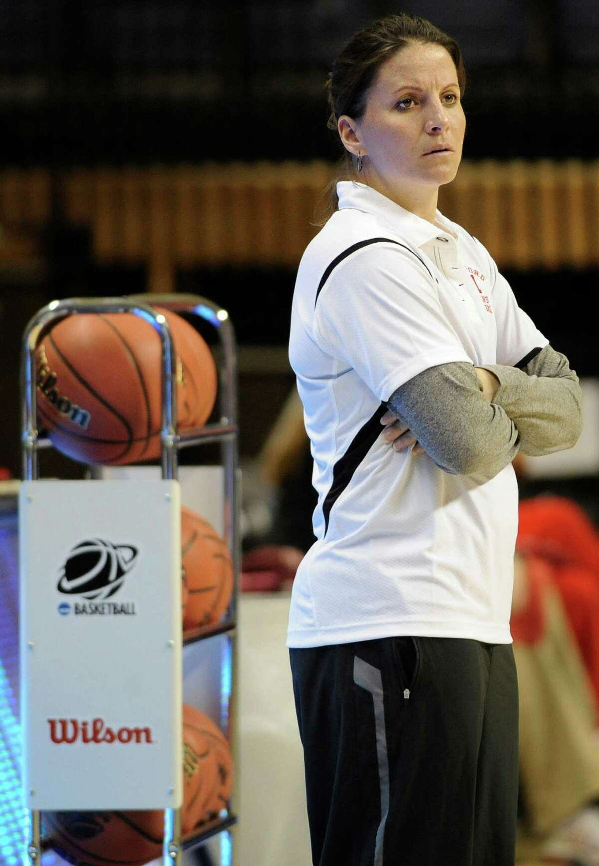 Hartford head coach Jennifer Rizzotti watches her team practice in the first round of the NCAA women's college basketball tournament Storrs, Conn., Saturday, March 19, 2011. Hartford plays Connecticut on Sunday. (AP Photo/Jessica Hill)